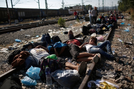 IDOMENI, GREECE - SEPTEMBER 02: Syrian and Iraqi migrants sleep on railroad tracks waiting to be processed across the Macedonian border September 2, 2015 in Idomeni, Greece. Since the beginning of 2015 the number of migrants using the so-called 'Balkans route' has exploded with migrants arriving in Greece from Turkey and then travelling on through Macedonia and Serbia before entering the EU via Hungary. The number of people leaving their homes in war torn countries such as Syria, marks the largest migration of people since World War II. (Photo by Win McNamee/Getty Images)